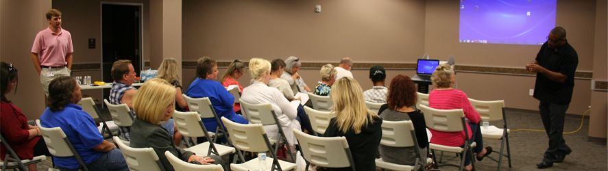 Medical Reserve Corps volunteers listen to a presentation