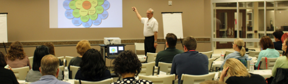 Picture of a presenter giving a presentation during a public health emergency preparedness class