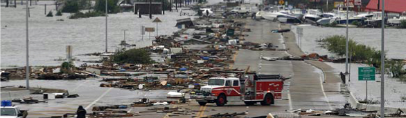 Picture of a road covered with debris from Hurricane Ike