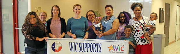 Picture of WIC families posing for a picture in clinic