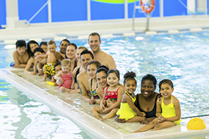 People In A Public Pool CDCs Healthy Swimming Behaviors