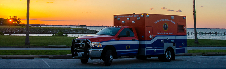 Picture of ambulance at sunset.