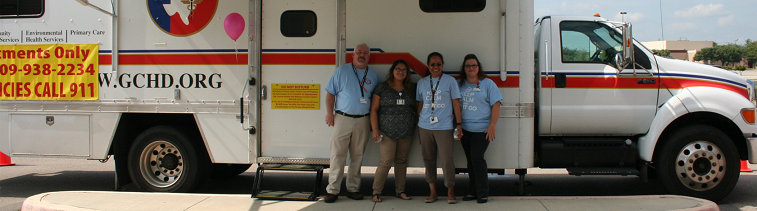 Staff posing with the mobile clinic