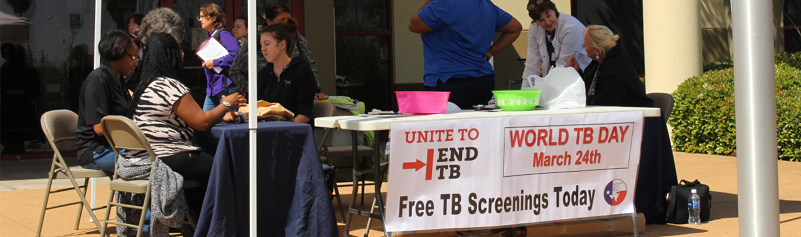 Picture of staff members at a booth during National TB Testing Day event